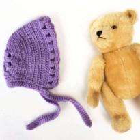 a crochet bonnet by La Visch Designs