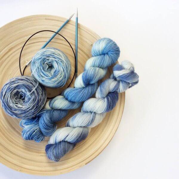 Blue yarn and knitting needles