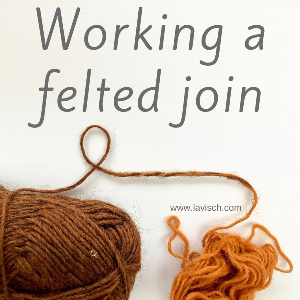 A ball of orange and brown yarn on a white background, joined together with a felted join.