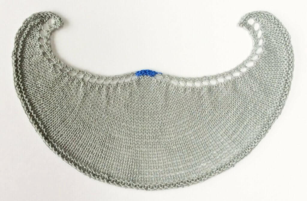Crescent shaped shawl with hump